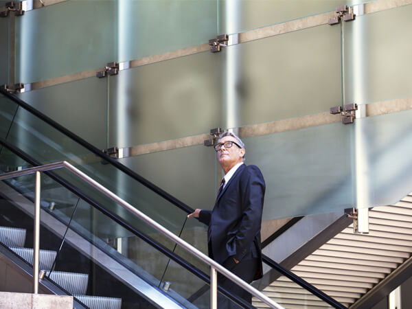 man walking up stairs in atrium