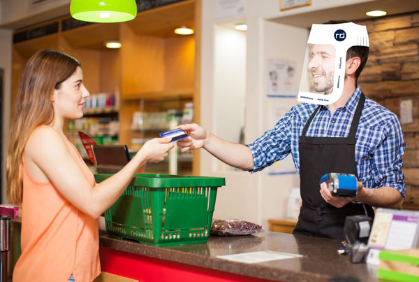 woman cashier wearing face shield at checkout