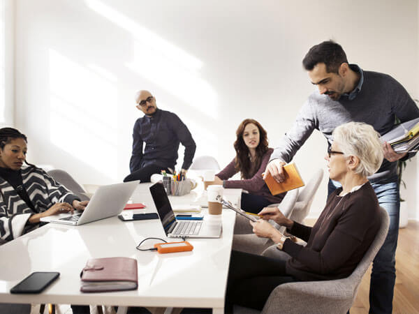 people at a conference table developing enterprise-level strategy