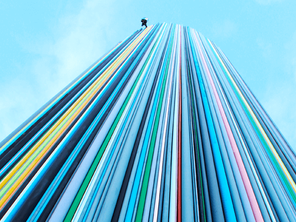 colorful wires in the shape of a skyscraper