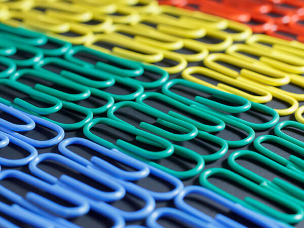 organized rows of colorful paperclips
